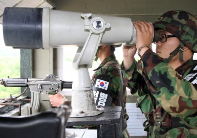 A South Korean soldier uses binoculars at the demilitarized zone between South and North Korea, in Paju,ttus on Monday. (Bloomberg)