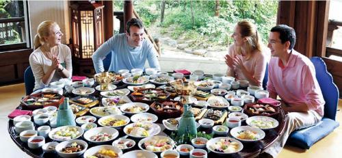 Diners enjoy a feast of Korean cuisine.