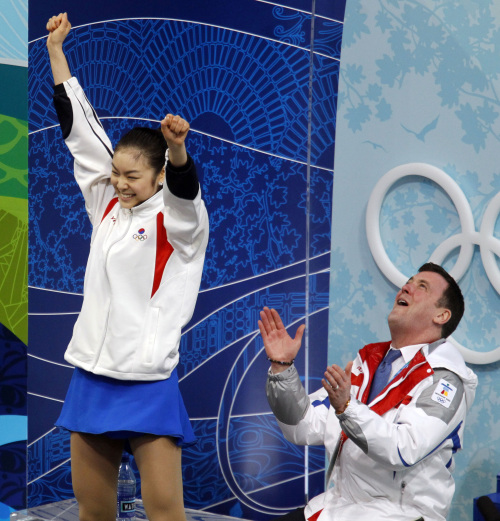 Kim Yu-na (left) and her coach, Brian Orser, react to her gold-medal score in the women's figure skating long program during the 2010 Winter Olympic Games in Vancouver, Canada, in Feb. 25, 2010. (MCT)