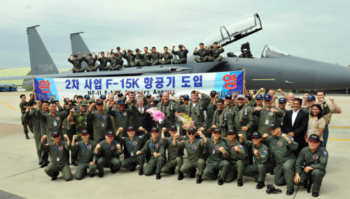 South Korean and U.S. officials pose in front of an F-15K fighter jet at an Air Force base in Daegu on Wednesday. (Air Force)