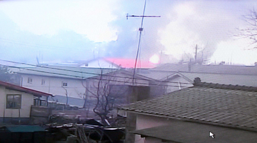 Houses on Yeonpyeong Island are shrouded in billowing smoke after North Korea bombarded the area with dozens of artillery shells on Tuesday, sending a high alert across South Korea. (Yonhap News)