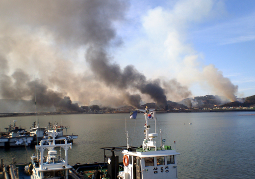 Smokes rising from Yeonpyeong Island (Korea Herald)