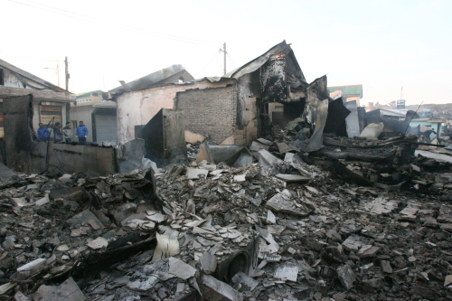 Houses on Yeonpyeong Island are seen to be severely damaged by the artillery attacks of North Korea on Tuesday. (Yonhap News)