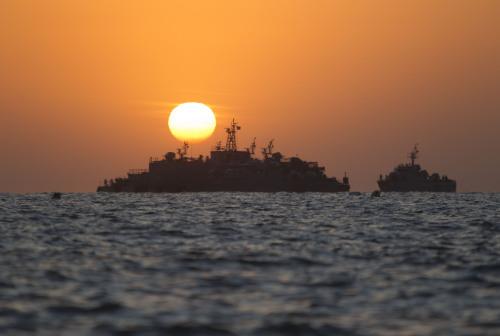 South Korean ships stage off of the coast of South Korea's Yeonpyeong Island Sunday, Nov. 28. (AP-Yonhap)