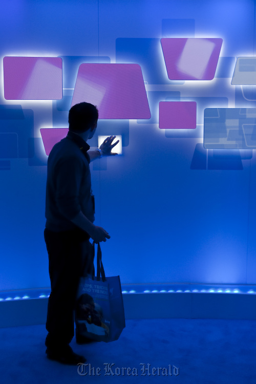 An attendee interacts with a touch sensitive Microsoft Corp. display during the 2010 International Consumer Electronics Show in Las Vegas. (Bloomberg)