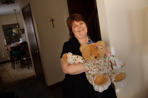 Karen Mead holds a teddy bear at her parents' home in Barrington, Illinois, Dec. 13, 2010. (Chicago Tribune/MCT)