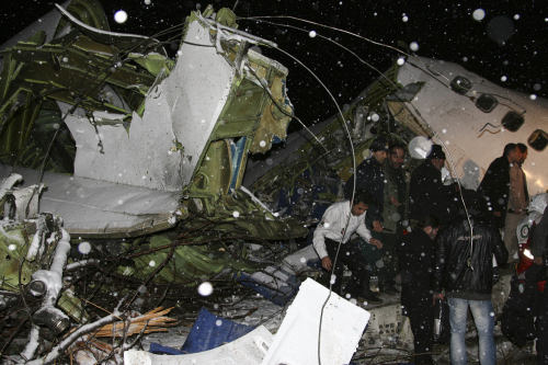 Rescuers work at the crash site of a passenger plane near the city of Uroumieh in northwest of Iran on Sunday. (Xinhua-Yonhap News)