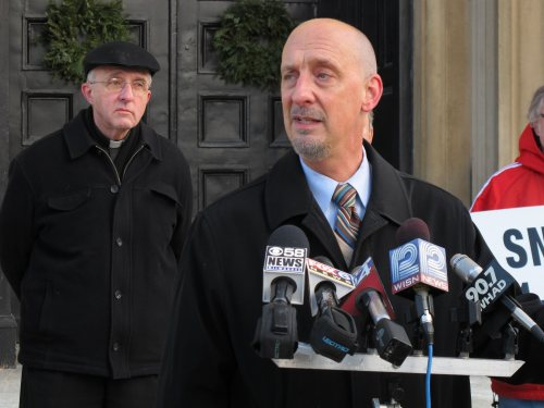 Peter Isely (right), an organizer with the Survivors Network of those Abused by Priests, also known as SNAP, speaks at a news conference in Milwaukee on Dec. 17, as the Rev. James Connell listens behind him. (AP-Yonhap News)