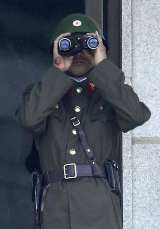 A North Korean Army soldier looks at the southern side using binoculars at the border village of Panmunjom, (DMZ), that separates the two Koreas since the Korean War. (AP)