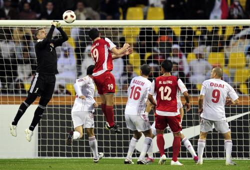 Jordan goalkeeper Amer Shafi (left) saves a shot against Syria. (Xinhua-Yonhap News)