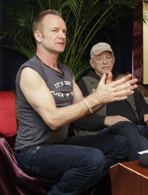 """Sting (left) talks as Ric O'Barry, former trainer for the 1960s """"Flipper"""" TV series and star of Oscar-winning documentary """"The Cove,"""" looks on during an interview in Tokyo Wednesday. (AP-Yonhap News)"""