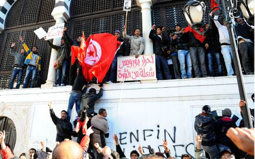 Inhabitants of the central Tunisia region of Sidi Bouzid chant slogans during a demonstration in front of the government palace in Tunis on Sunday. (AFP-Yonhap News)