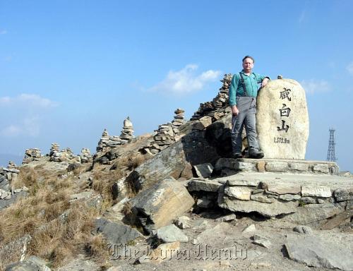 David Mason stands on top of 1572.9-meter Mount Hambaek, part of the Baekdu-daegan mountain system.