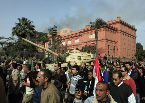 Egyptian protesters march in front of the Egyptian Museum in Cairo on Saturday. (AP-Yonhap News)
