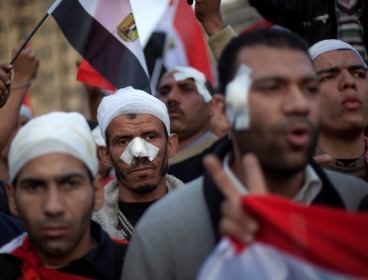 Wounded anti-government protestors march during a demonstration in Tahrir Square, Cairo, Egypt, on Friday. (Yonhap-AP)