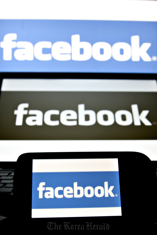 Facebook Inc. logos are displayed on computer screens (Bloomberg)