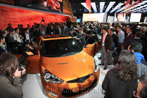 Visitors view the Veloster at the North American International Auto Show in Detroit in January. (Hyundai Motor Co.)