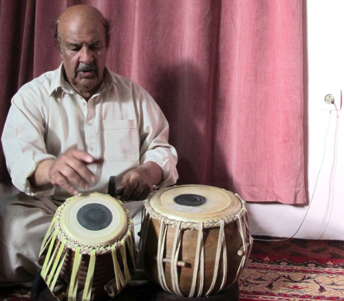 Asif Mahmoud plays the tabla at his Kabul, Afghanistan home and studio.(Los Angeles Times/MCT)