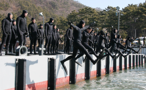 The Underwater Demolition Team (UDT) jumps into a cold water during a military training. (Yonhap News)