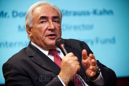 """Dominique Strauss-Kahn, managing director of the International Monetary Fund, delivers an address on """"The Global Economic Outlook and Asia's Role in the Global Economy,"""" in Singapore, on Feb. 1. (Bloomberg)"""
