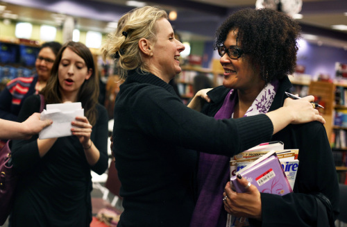 Tonya Melendez (right) meets author Elizabeth Gilbert after Gilbert recently staged a reading and signed books at a book store in Oak Brook, Illinois. (Chicago Tribune/MCT)