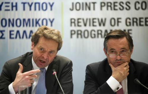 International Monetary Fund representative Poul Thomsen (left) and European Commission representative Servaas Deroose speak during a press conference in Athens on Friday. (AFP-Yonhap News)
