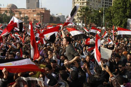 Egyptians celebrate in Cairo's Tahrir Square, the epicenter of the popular revolt that drove veteran strongman Hosni Mubarak from power, Saturday. (AFP-Yonhap News)