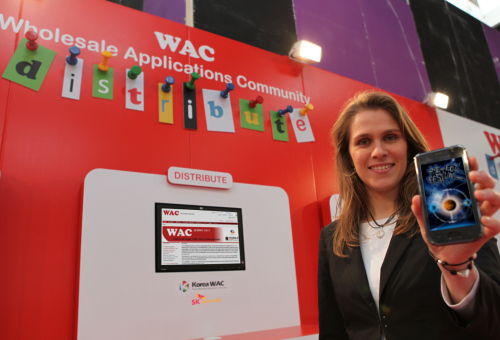 A model introduces the Wholesale Application Community platform at the Mobile World Congress in Barcelona. (SK Telecom)