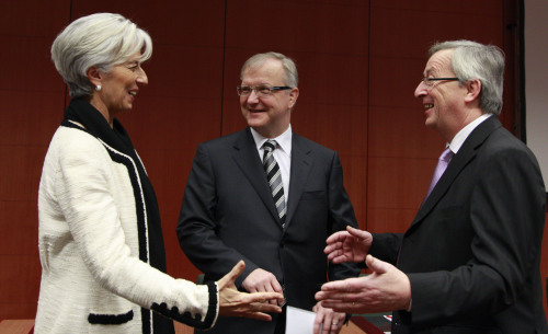 From left: French Finance Minister Christine Lagarde, European Commissioner for the Economy Olli Rehn and Luxembourg's Finance Minister Jean Claude Juncker share a word during a meeting of eurozone finance ministers at the EU Council building in Brussels on Monday. (AP-Yonhap News)