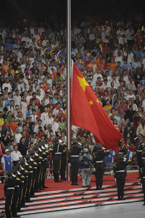 The Chinese flag is raised in the National Stadium during the opening ceremony on Friday, August 8, 2008, to kick off the Games of the XXIX Olympiad in Beijing, China.(MCT)