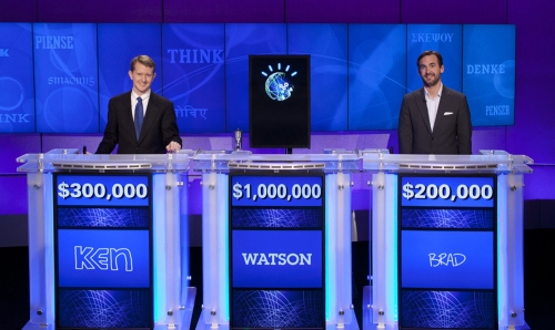 """Ken Jennings (left) and Brad Rutter (right) after the episode of """"Jeopardy!"""" that aired Wednesday, when Watson, the IBM-created megabrain, beat the veteran champs with a total of $77, 147 over two exhibition matches. (AP-Yonhap News)"""