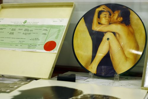 A picture of a copy of the marriage certificate of John Lennon and Yoko Ono and a CD of the couple is displayed at the Beatles museum in Buenos Aires. (AFP-Yonhap News)