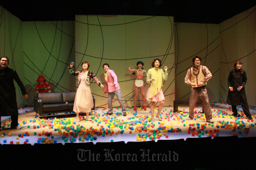 """Actors and actresses throw rubber balls at the audience near the end of the play """"La Cantatrice Chauve."""" (Aga Company)"""