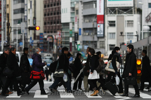 Morning commuters make their way to work at a station in Tokyo. (Bloomberg)