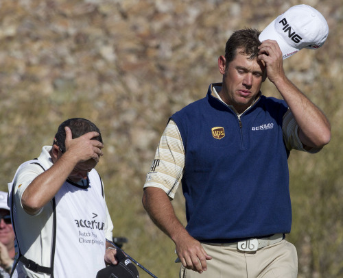 Lee Westwood (right) reacts after losing to Nick Watney during the second round of the Match Play Championship golf tournament Thursday in Marana, Arizona. (AP-Yonhap News)