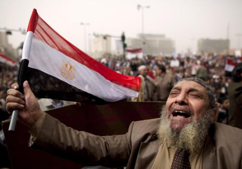 An Egyptian protester chants slogans at a rally demanding Libyan leader Moammar Gadhafi step down during demonstrations in Tahrir Square in Cairo, Friday. (AP-Yonhap News)
