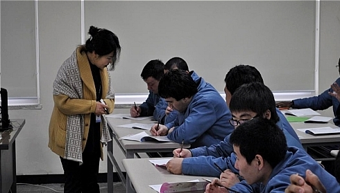 Inmates take a Korean language lesson at the Cheonan Foreigner Prison.
