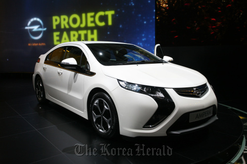 Opel's Ampera electric-drive automobile is seen on the company stand during the Geneva International Motor Show on Tuesday. (Bloomberg)