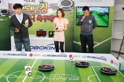 LG Electronics' Roboking robot vacuum cleaners play soccer in a tournament hosted by the company on Tuesday in Seoul. (LG Electronics)