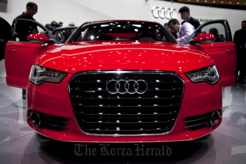 The 2012 Audi AG A6 sedan sits on stage following its unveiling at the North American International Auto Show in Detroit, Michigan. (Bloomberg)