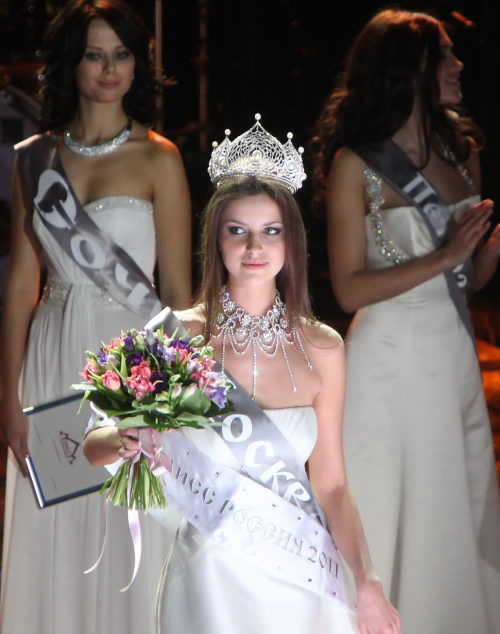 Crowned Natalia Gantimurova poses for photos during the final of Miss Russia pageant in Moscow, Russia, March 5, 2011.