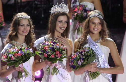 Natalia Gantimurova (C), winner of Miss Russia 2011, poses for photos during the final of Miss Russia pageant in Moscow, Russia, March 5, 2011.