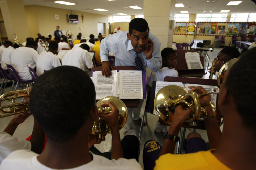 Director's assistant Tommy Curtain conducts practice of the St. Augustine High School marching band at school's cafeteria in New Orleans, Louisiana. (MCT)