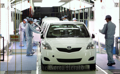 Workers make a final inspection of Toyota Motor Corp. Yaris vehicles on the production line of Central Motor Co.'s Miyagi plant in Ohira Village, Miyagi Prefecture, Japan. (Bloomberg)