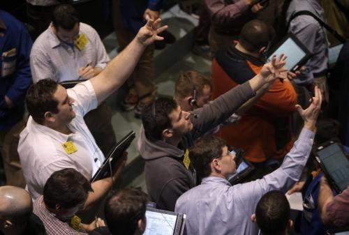Traders work in the oil options pit at the New York Mercantile Exchange in New York on Monday. (AP-Yonhap News)