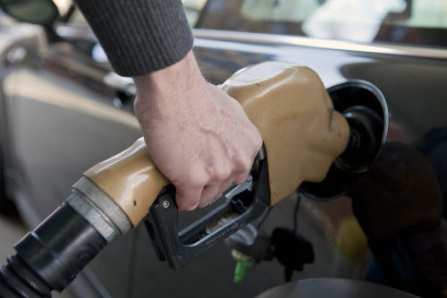 A fuel nozzle is placed into a vehicle at a filling station in this arranged photo in Washington, D.C. on Thursday. (Bloomberg)