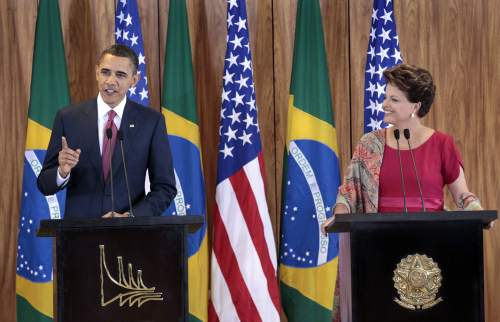 U.S. President Barack Obama (left) with Brazilian President Dilma Vana Rousseff during their joint news conference at the Palacio do Planalto in Brasilia, Saturday. (AP)