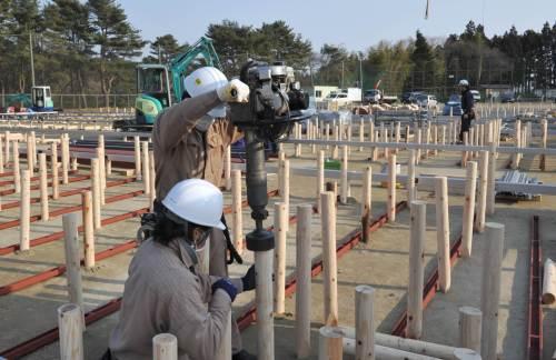 Workers begin constructing temporary housing in the devastated town of Rikuzentakata on Saturday. (AFP-Yonhap News)