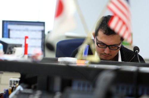 A currency trader works at a foreign exchange brokerage in Tokyo. (Bloomberg)