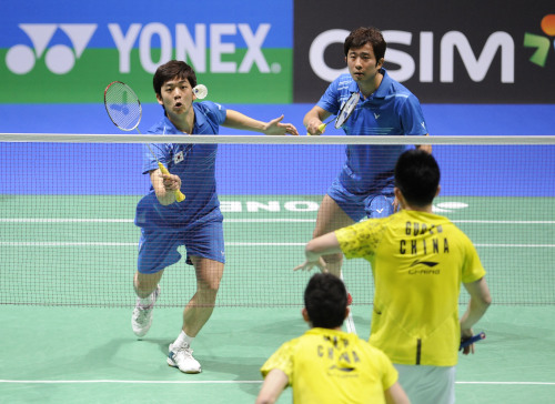 Korea's Lee Yong-dae (left) and Jung Jae-sung compete during the men's doubles second round match at the All England Open Badminton Championships earlier this month. (Xinhua-Yonhap News)